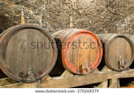 Wooden wine barrels in an underground cellar, Melnik, Bulgaria - stock photo