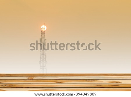 wooden with Silhouette phone antenna on Sunset background,soft focus - stock photo
