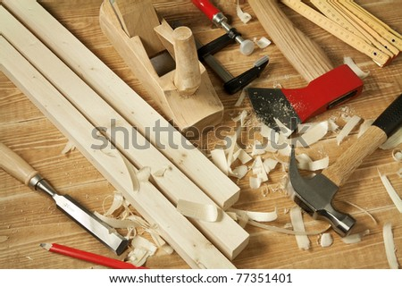 Wooden workshop table with tools. - stock photo