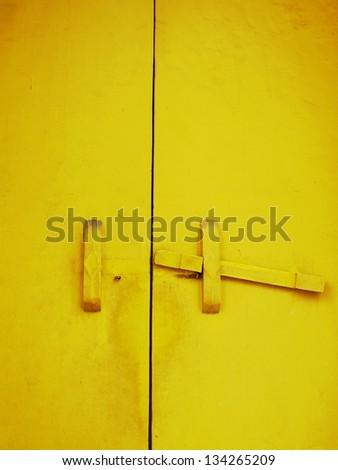Wooden yellow door - stock photo
