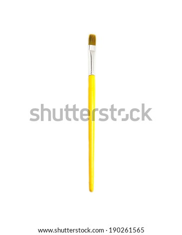 Wooden yellow Paint Brush isolated over white - stock photo