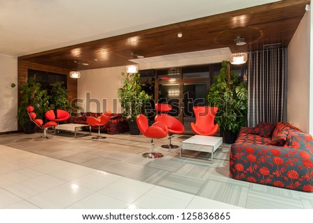 Woodland hotel - Hotel hall with red decorations - stock photo