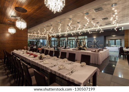 Woodland hotel - Huge restaurant room in hotel - stock photo