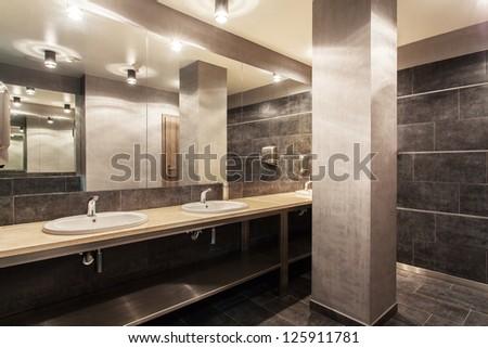 Woodland hotel - Interior of modern and grey bathroom - stock photo