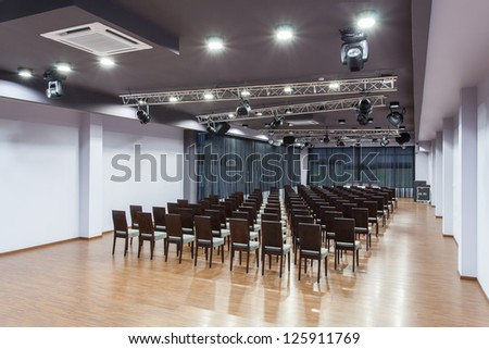 Woodland hotel - Spacious conference room with chairs - stock photo