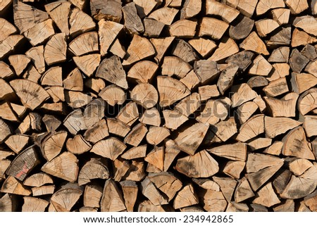 Woodpile as a fullframe background - stock photo