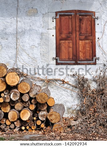woodpile in the window of a cottage