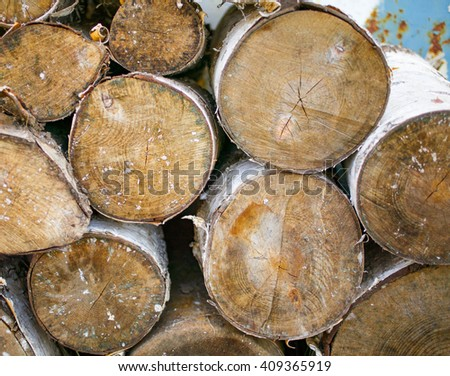 Woodpile of birch firewood. End faces of logs. Background texture - stock photo