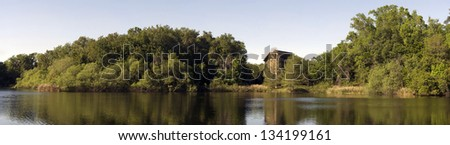 Woods and a lake. - stock photo