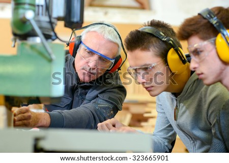 Woodwork apprenticeship - stock photo