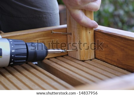 Woodwork putting in screws - stock photo