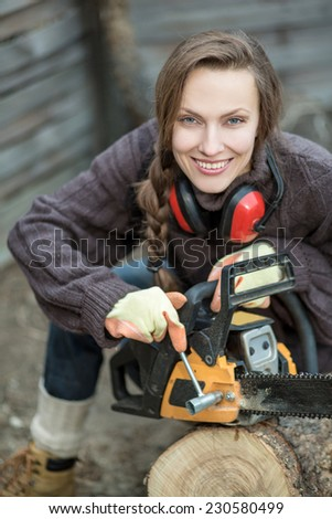 woodworker with chainsaw - stock photo