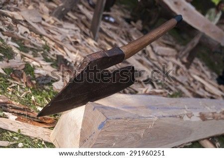 woodworkers axe and handmade joist - stock photo