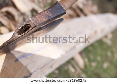 Woodworkers Sharp axe and handmade bearer - stock photo