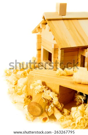 Woodworking. House construction. Joiner's works. The small wooden house, plane and shaving on white background. - stock photo