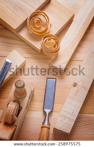 woodworking tools plane chisels wooden planks and shavings  - stock photo