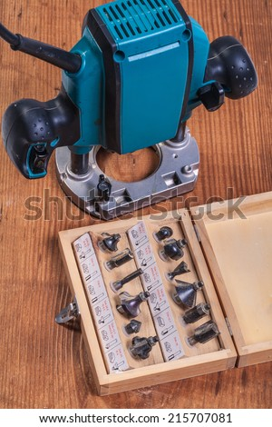 woodworking tools �¢?? set of roundover router bits in box and plunge pouter on old wooden board - stock photo