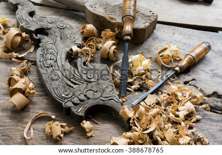 Woodworking tools with wooden background and shavings - stock photo