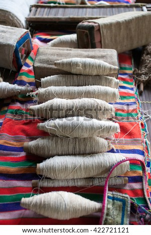 wool and looms of Montagnards in Vietnam - stock photo