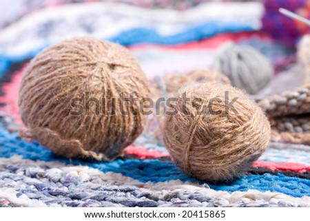 wool ball on a homemade carpet - stock photo