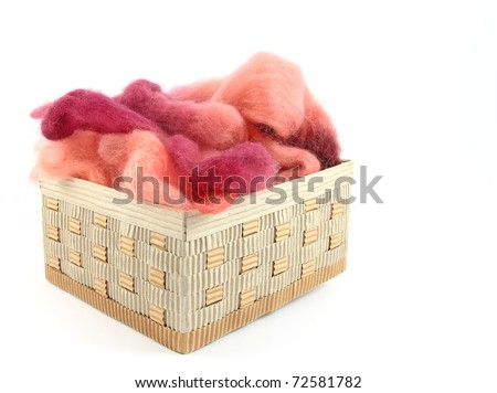 Wool for felting in basket - stock photo