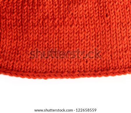 Wool knitted textured background with white copy space - stock photo