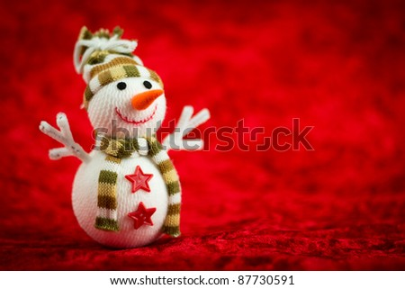 Wool snowman on a red background - stock photo