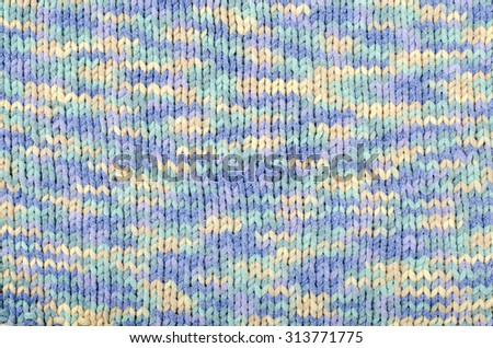 Wool sweater pattern as a background. Close up on blue and white degrade knit sweater texture fabric. - stock photo