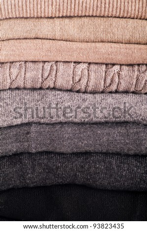 wool sweaters as close up - stock photo