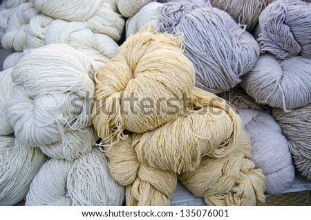 wool thread in agriculture street market - stock photo
