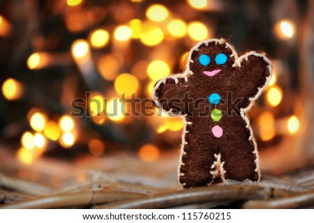 wool toy on a branch of spruce. Christmas background Rasfokus - stock photo