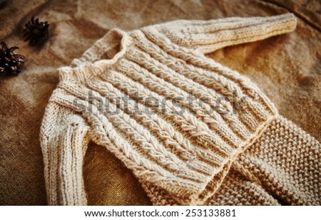 Woolen baby clothes. Woolen. Ecological clothes. Handmade. natural. - stock photo