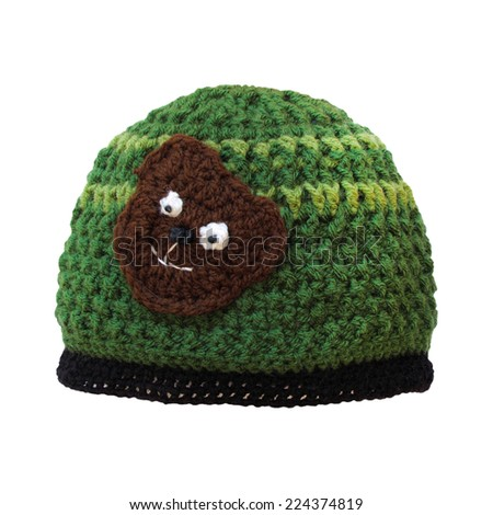 Woolen cap with teddy bear for child isolated on white. Crochet handmade cute hat.  - stock photo