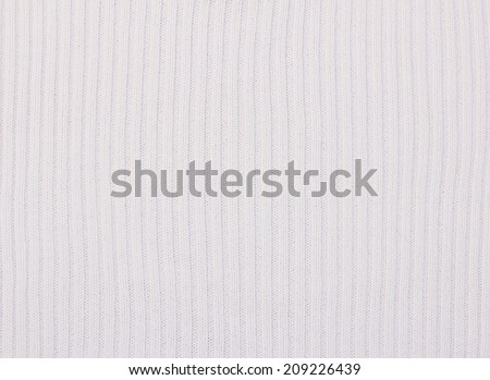 woolen knitwear background with ripped surface, vertical striped - stock photo