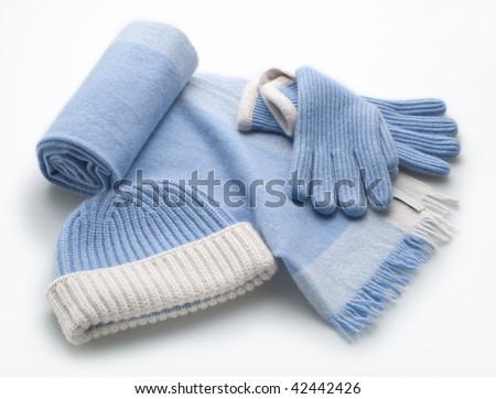 woolen light blue scarf, gloves and hat over white