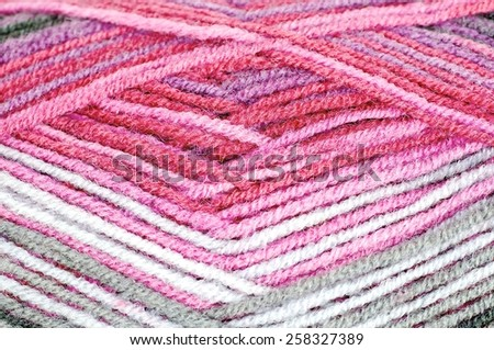 Woolen thread and knitting needle. Needlework accessories isolated on white background.  - stock photo