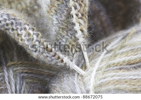 Woollen thread and knitting needle. Needlework accessories isolated on white background. - stock photo