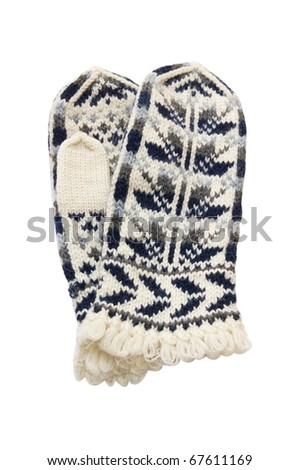 Woollen winter mittens with an ornament. On a white background - stock photo