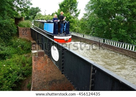 WOOTTON WAWWEN, ENGLAND. JULY 1 The Stratford on Avon Canal from Kings Norton Birmingham to Stratford on Avon is carried on an aquaduct over a road at Wootton Wawwen. July 1 in Wootten Wawwen, England - stock photo