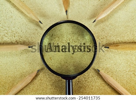 Word Analysis under magnifying glass on vintage background - stock photo