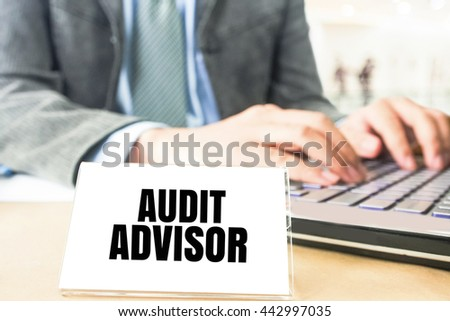 word audit advisor white card on blurred business man using computer laptop office desk background - stock photo
