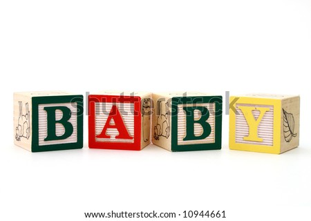word baby formed by alphabet wood blocks on a white surface