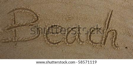 "word ""Beach"" written in the sand on the beach - stock photo"
