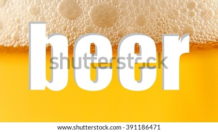 "Word ""beer"" is cut out from the texture of light beer with foam. Macro. White Background."