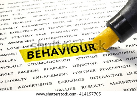 Word Behaviour highlighted with marker on paper of other related words. For direction of business marketing concept - stock photo