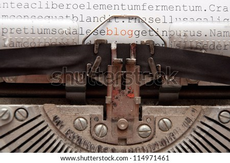 word 'blog' and other text written on an old typewriter - stock photo