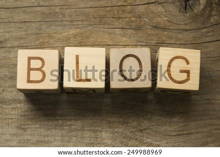 Word Blog on a wooden cubes - stock photo