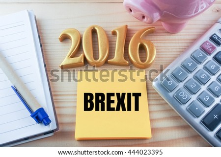 word brexit 2016 on post it note calculator and piggy bank background vintage tone,financial concept - stock photo