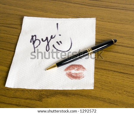Word Bye and a smiley face on the napkin (with pen) - stock photo