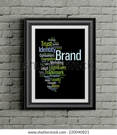 Word cloud illustrating the concept of brand hanging on a metallic frame hanging on a grungy wall as a background  - stock photo